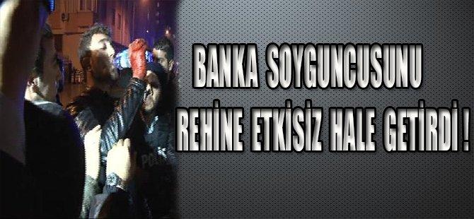 BANKA SOYGUNCUSUNU REHİNE ETKİSİZ HALE GETİRDİ !