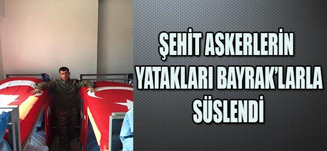 ŞEHİT ASKERLERİN YATAKLARI BAYRAK'LARLA SÜSLENDİ