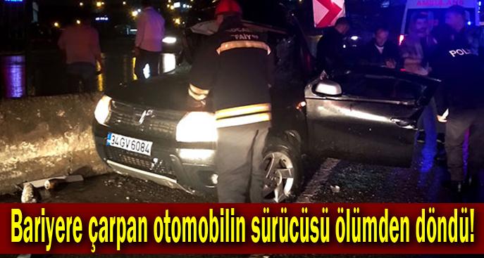 Bariyere çarpan otomobilin sürücüsü ölümden döndü!