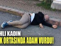 Silahlı kadın sokak ortasında tartıştığı adamı vurdu!